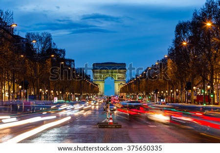 PARIS, FRANCE - FEBRUARY 07, 2016: Arc de triomphe Paris city at sunset - Arch of Triumph and Champs Elysees