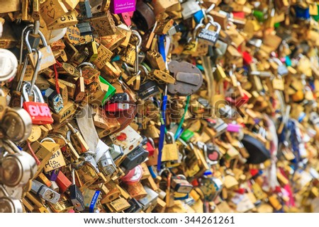 PARIS, FRANCE - FEBRUARY 18, 2014: Close up of the padlocks on the Pont de l'Archeveche (Archbishop's Bridge) in Paris, France, February 2014 - stock photo