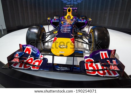 PARIS, FRANCE - FEBRUARY 20, 2014: Formula 1 Red Bull Renault in the showroom on the Champs Elysees in Paris, France, on February 20, 2014 - stock photo