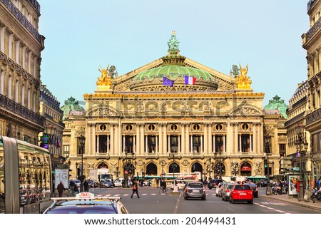 PARIS, FRANCE - FEBRUARY 24 : Front view of the Old Garnier Opera house in Paris with people and cars on the busy street on February 24th, 2014 in Paris, France - stock photo