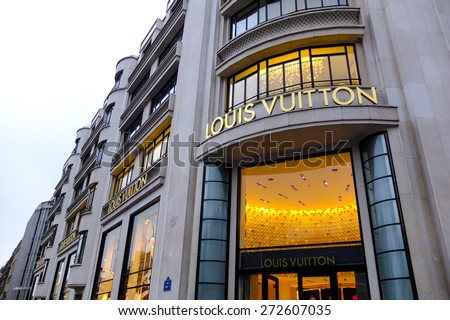 PARIS, FRANCE - FEBRUARY 25 : Louis Vuitton's clothing store in Champ Elysees Avenue on February 25, 2012 in Paris, France. - stock photo