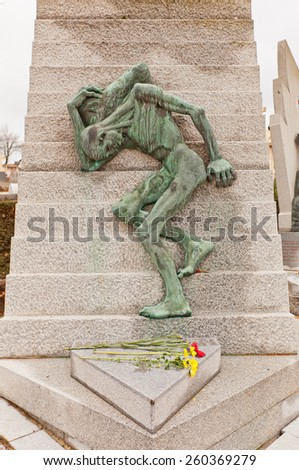 PARIS, FRANCE - FEBRUARY 21, 2015:  Monument in memory of victims of Mauthausen camp on Pere Lachaise Cemetery in Paris. Mauthausen was a large German concentration camp in Upper Austria. - stock photo