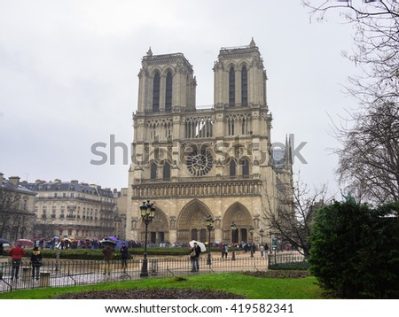 Paris, France - 13 February 2016: Notre-Dame Cathedral on a Cloudy and Rainy day.