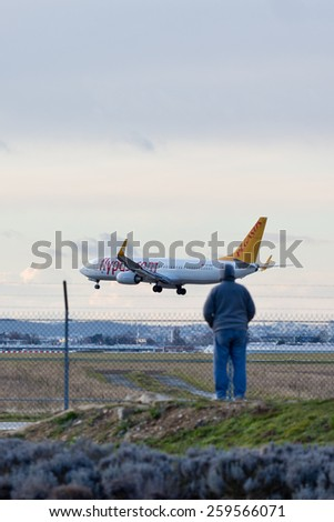 PARIS, FRANCE - FEBRUARY 21, 2015: Pegasus Airlines Boeing 737-82R lands at ORLY Airport (ORY) before a plane spotter. Pegasus is a low cost airline of Turkey. - stock photo