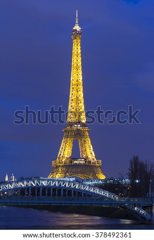 Paris, France-February 15, 2016 : The Eiffel tower is a historical monument ,one of the most visited in the world, located on the bank of Seine river in Paris, France.