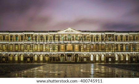 Paris, France - 13 February 2016: The famous square courtyard building of the Louvre Museum at night. - stock photo