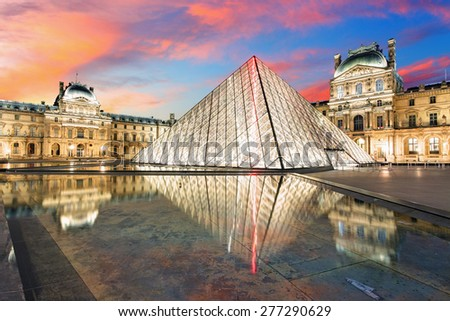 Paris, France - February 9, 2015: The Louvre Museum is one of the world's largest museums and a historic monument. A central landmark of Paris, France. - stock photo