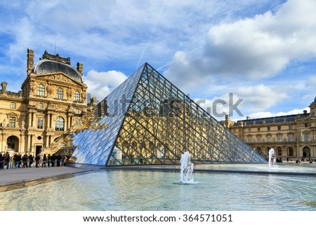 PARIS, FRANCE - FEBRUARY 23, 2014: Tourists visit the Louvre museum in Paris, France, on February 23, 2014  - stock photo