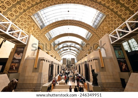PARIS, FRANCE - FEBRUARY 19, 2013: Visitors in Musee d'Orsay. Since it's opening in 1986, Musee D'Orsay houses the largest collection of impressionist and post-impressionist masterpieces in the world. - stock photo