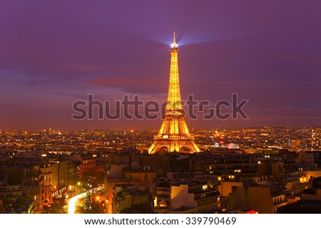 PARIS, FRANCE - JAN 18, 2015: Eiffel Tower Light Performance Show at night. The Eiffel tower is the most visited monument of France.