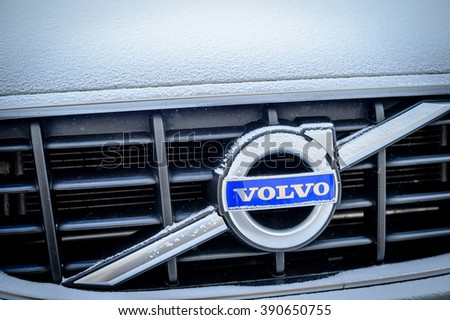 PARIS, FRANCE - JAN 20, 2016: Volvo Cars logotype covered with snow flakeson car front. Volvo is the only car maker that thas the biggest 5 star NCAP test results - stock photo
