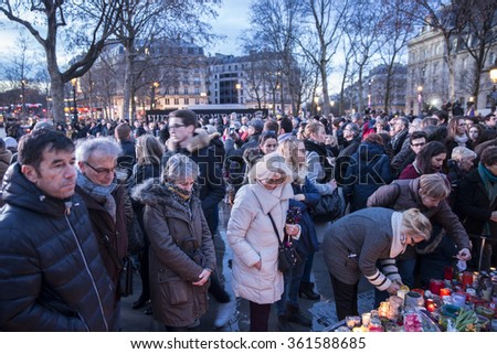 PARIS, FRANCE - January 10, 2016: ceremony place de la republique to commemorate victims of the bombing and shooting rampage, commemoration of Charlie Hebdo terrorist attack. - stock photo