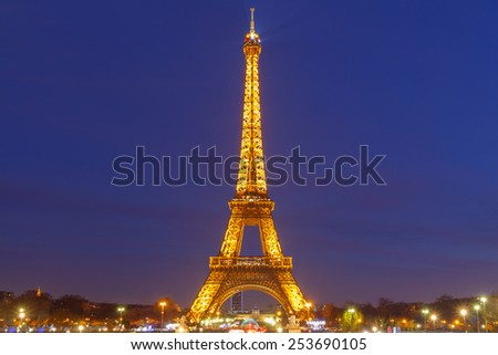 Paris, France - January 1, 2015:  Eiffel Tower at sunset. Trocadero, an observation deck. One of the most visited tourist destinations in Paris.