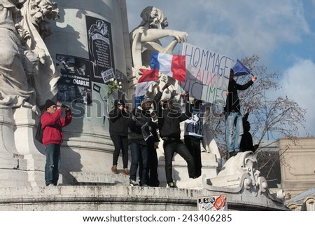 PARIS, FRANCE-JANUARY 11, 2015: Manifestation on Republic Square in Paris against terrorism and in memory of the attack against satirical newspaper Charlie Hebdo.  - stock photo