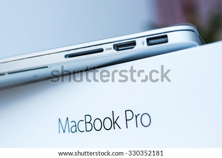 PARIS, FRANCE - JANUARY 14, 2015: New Apple MacBook Pro laptop with retina display and force touch  during the unboxing - stock photo