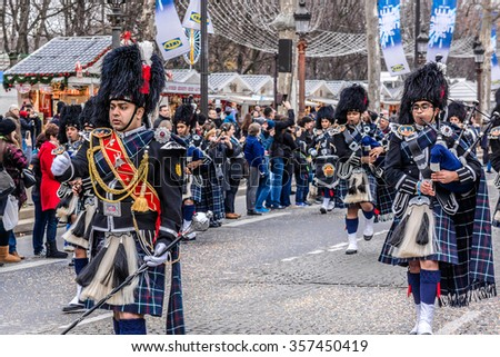 PARIS, FRANCE - JANUARY 1, 2016: Paris New Year Parade (Grande Parade de Paris) is an annual international parade on the famous Champs Elysees involving musicians and dancers from Europe and America. - stock photo