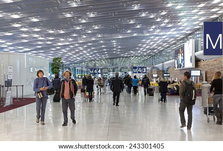 PARIS, FRANCE- JANUARY 07, 2015: Passengers are seen at the Paris Charles de Gaulle Airport, one of the principal aviation centres of the world and the principal hub for Air France. - stock photo