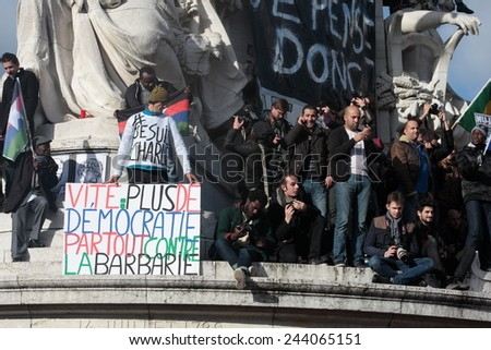 PARIS, FRANCE-JANUARY 11, 2015: Slogan defending democracy during manifestation on Republic Square in Paris against terrorism and in memory of the attack against satirical newspaper Charlie Hebdo.  - stock photo