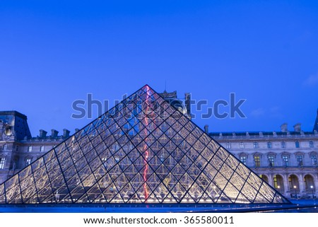 Paris; France-January 15, 2016: The Louvre pyramide based in the main courtyard(cour Napoleon) of the Louvre Palace in Paris, France.It serves as the main entrance to the Louvre museum. - stock photo