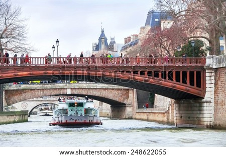 Paris, France - January 10, 2015. View of Seine river, boats (ships), bridge, people and coast (quay) in Paris in evening. Paris is the best destinations in Europe. Travel (vacation) concept. - stock photo