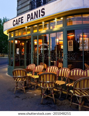 Paris, France - July 20, 2011 - A cafe on the Left Bank of Paris awaits diners. The cafe lifestyle draws millions of tourists to Paris each year.