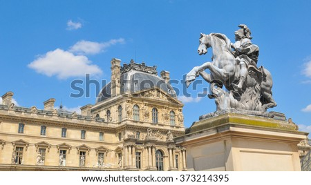 Paris, France - July 9, 2015: Architectural detail of equestrian statue at the Louvre Museum, major landmark in the French capital city and worldwide - stock photo