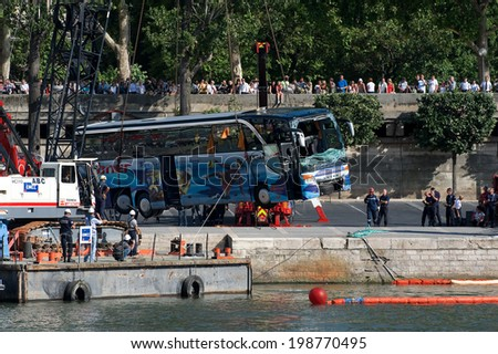 PARIS, FRANCE - JULY 27, 2010 : Austrian bus fell into the Seine at the foot of the Eiffel Tower