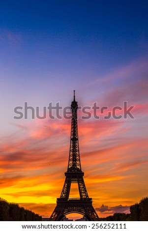 PARIS, FRANCE - JULY 14 2014: Eiffel Tower at sunset is the most visited monument in France and the most famous symbol of Paris, July 14, 2014 - stock photo