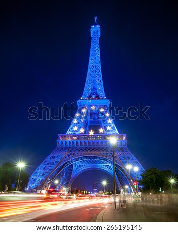 Paris, France - July 25, 2008 : Eiffel Tower glowing blue illuminated at night. Emblem of the EU in the Eiffel Tower. The Eiffel tower is the most visited monument of France. - stock photo
