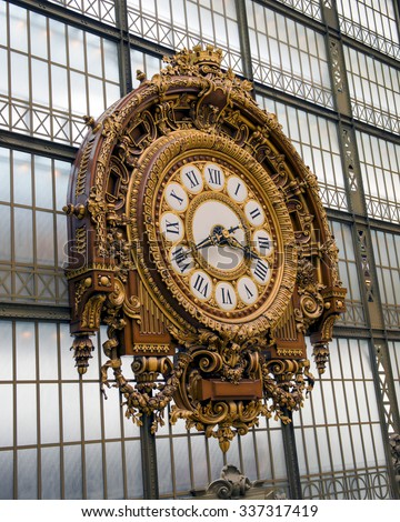 PARIS, FRANCE - JULY 25, 2015: Golden clock of the museum D'Orsay in Paris, France. - stock photo
