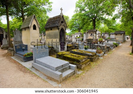 PARIS, FRANCE - JULY 27, 2015: Graves and monuments in cemetery Pere Lachaise in Paris in France, a lot of famous people are buried here  - stock photo
