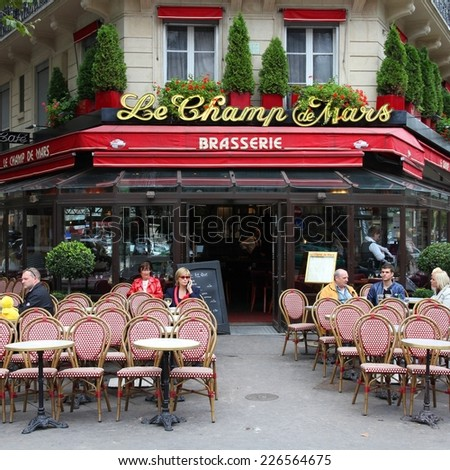 PARIS, FRANCE - JULY 21, 2011: Le Champ de Mars cafe in Paris, France. Le Champ de Mars cafe is a typical establishment for Paris, one of largest metropolitan areas in Europe. - stock photo