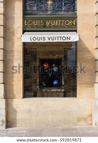 Paris, France - July 02, 2016: Louis Vuitton shop window in place Vendome in Paris. Louis Vuitton or shortened to LV, is a French fashion house founded in 1854 by Louis Vuitton