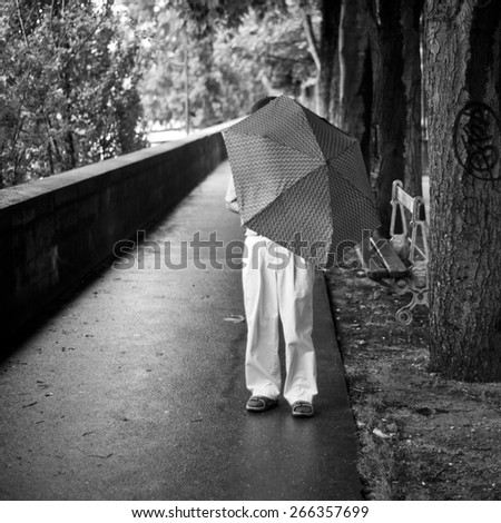 PARIS - france -  7 July 2012 - man with umbrella by  rainy day