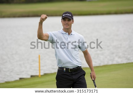 PARIS FRANCE, 05 JULY 2009. Martin Kaymer (GER) punches the air after winning the final round of the PGA European Tour Open de France golf tournament. - stock photo