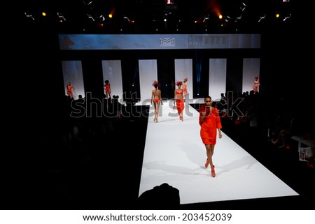 PARIS, FRANCE - JULY 5, 2014: Models walk the runway at Mode City, a swimwear and lingerie tradeshow where over 20,000 buyers meet 500 exhibitors from 35 different countries. - stock photo