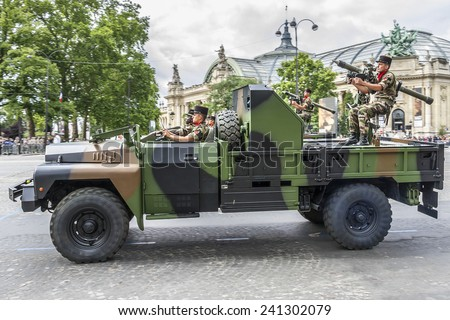 PARIS, FRANCE - JULY 14, 2012: Motorized and armored forces at a military parade (Defile) in the Republic Day (Bastille Day) on the Champs Elysees.