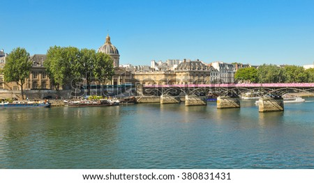 Paris, France - July 9, 2015: Panorama of Paris with Pont des Arts and the Seine River in summer - stock photo