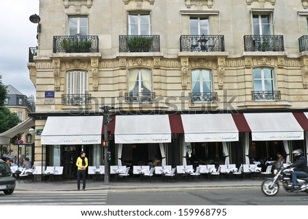 PARIS, FRANCE - JULY 10: Parisian on the street of town on July 10, 2012 in Paris, France - stock photo