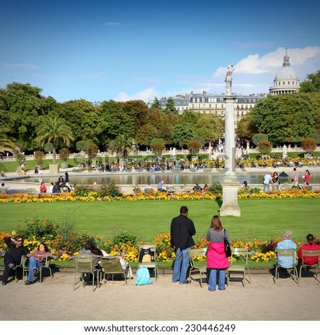 PARIS, FRANCE - JULY 23, 2011: People visit Luxembourg Gardens in Paris, France. Luxembourg area is popular among tourists in Paris, the most visited city worldwide. - stock photo