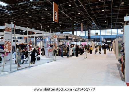 PARIS, FRANCE - JULY 5, 2014: People visit stands at Mode City, a swimwear and lingerie tradeshow where over 20,000 buyers meet 500 exhibitors from 35 different countries. - stock photo