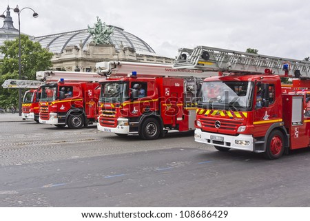 PARIS, FRANCE - JULY 14: Sapper and fire machinery at a military parade (Defile) in the Republic Day (Bastille Day) on the Champs Elysees in Paris, France on July 14, 2012