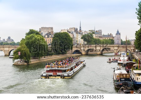 PARIS, FRANCE - JULY 14 2014: Seine and Notre Dame de Paris cathedral is one of the most visited places in France and one of the most famous symbols of Paris, July 14, 2014 - stock photo