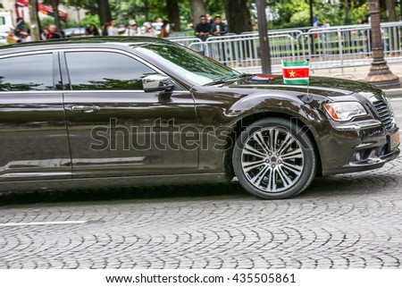 PARIS, FRANCE - JULY 14, 2014: Suriname Diplomatic car during Military parade (Defile) in Republic Day (Bastille Day). Champs Elysees. - stock photo