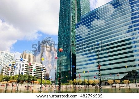 PARIS, FRANCE - JULY 31, 2016: Takis Pool and skyscrapers in Defense.  La Defense is a major business district of Paris and a largest open-air contemporary art gallery in France.