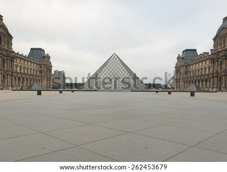 Paris, France, July - 12: The Louvre Museum in morning, 2014 in Paris France. The Louvre is the biggest Museum in Paris displayed over 60,000 square meters of exhibition space. - stock photo