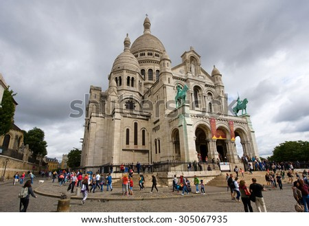 PARIS, FRANCE - JULY 27, 2015: Tourists are visiting the Sacre Coeur cathedral in Montmarte in Paris in France - stock photo