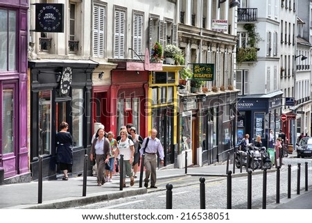 PARIS, FRANCE - JULY 22, 2011: Tourists visit Montmartre district in Paris, France. Paris is the most visited city in the world with 15.6 million international arrivals in 2011. - stock photo