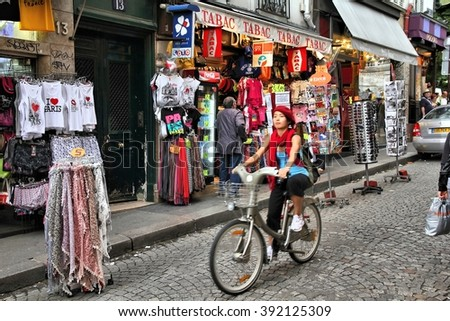 PARIS, FRANCE - JULY 22, 2011: Tourists visit Rue de Steinkerque in Paris, France. The street is one of most famous shopping areas in Monmartre district. Paris is the most visited city worldwide.