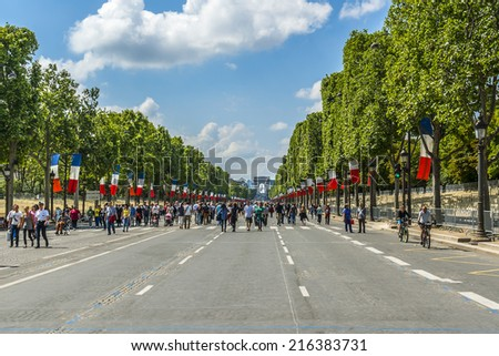 PARIS, FRANCE - JULY 14, 2014: View of Champs-Elysees - most famous avenue of Paris has 1910m and is full of stores, cafes and restaurants. First and only on holiday Champs-Elysees steel pedestrian.